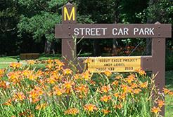 Street Car Park sign white flowers on front
